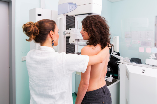 Nurse With Young Women Having A Mammography Stock Photo - Download Image Now