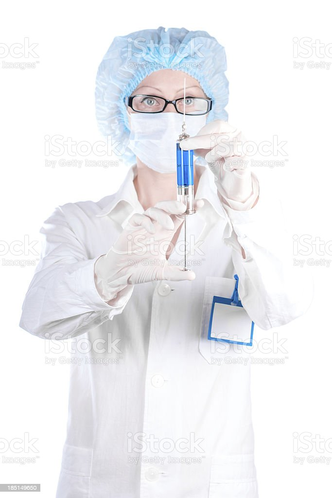 Nurse woman holding in his hand syringe with a vaccine royalty-free stock photo