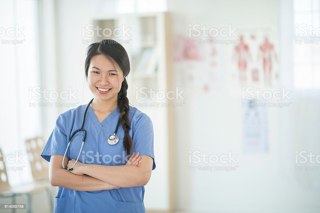 Nurse Working at the Doctors Office stock photo