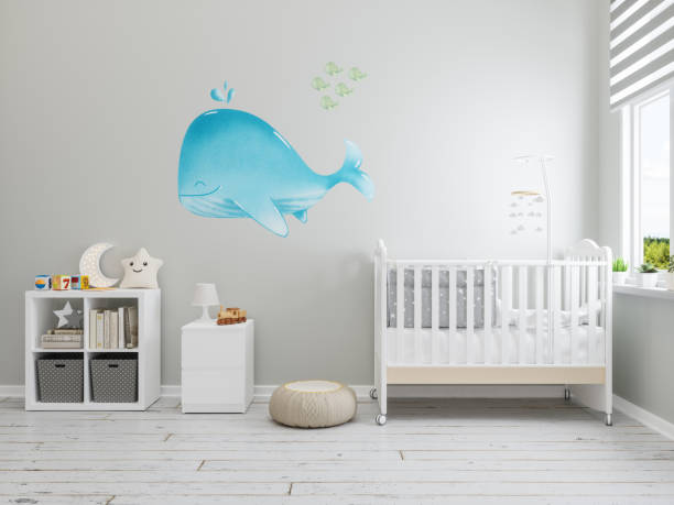 Nursery Interior with Whale Wallpaper On The Wall Nursery Interior with Whale Wallpaper On The Wall crib stock pictures, royalty-free photos & images