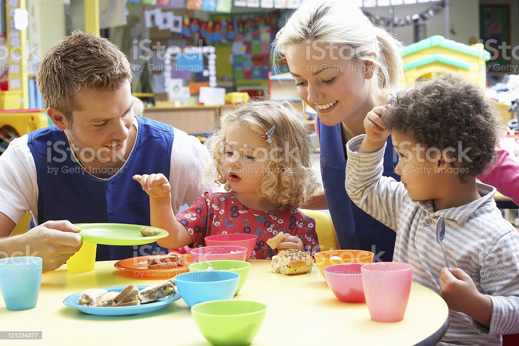Preschool Lunch Table To Smiling Teacher Enjoying With Kids During Lunch Break At Preschool Pictures Images And Stock Photos Royalty Free