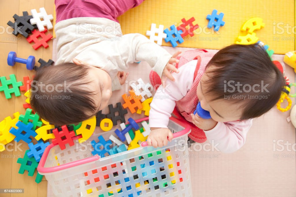 Nursery school children play with toys stock photo