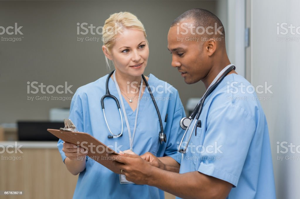 Nurses checking medical reports stock photo