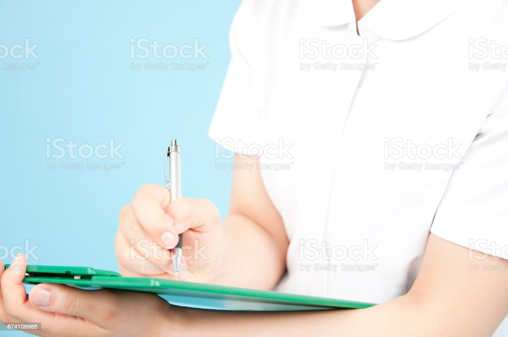 Nurses take notes at hand royalty-free stock photo