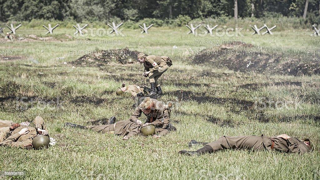 Nurses treating injured soldiers stock photo