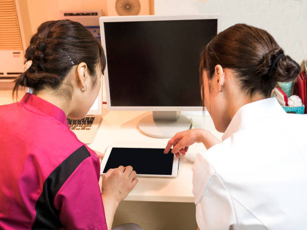Nurses who check information using a tablet. stock photo