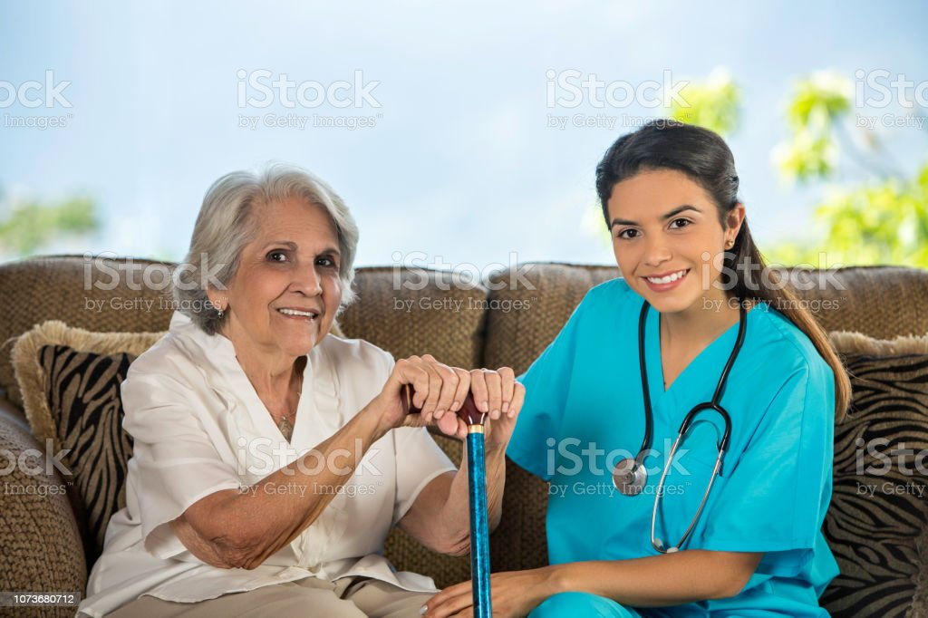Health Themes. Nursing home assistance. Young Hispanic female doctor...