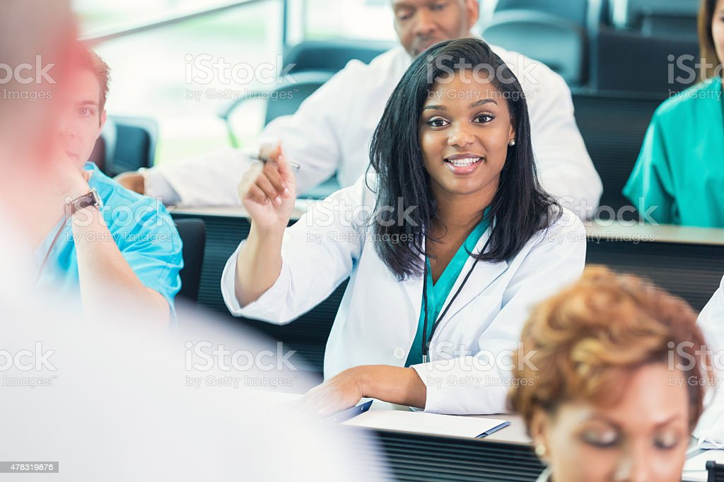 Nursing or medical student asking question during healthcare conference stock photo