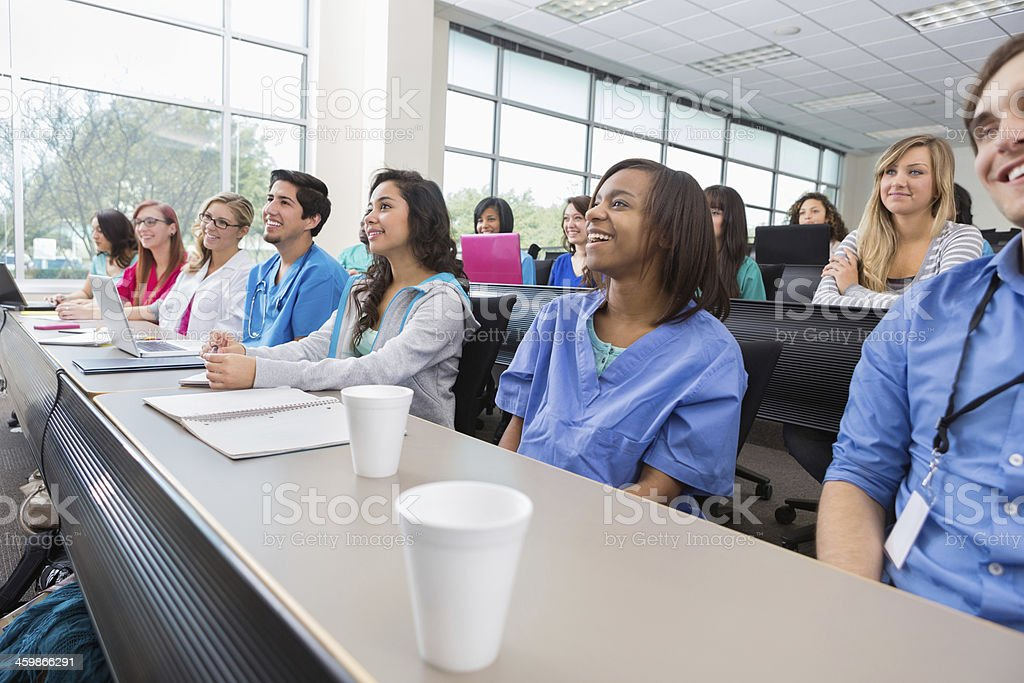 Nursing or medical students listenting to professor in lecture hall stock photo