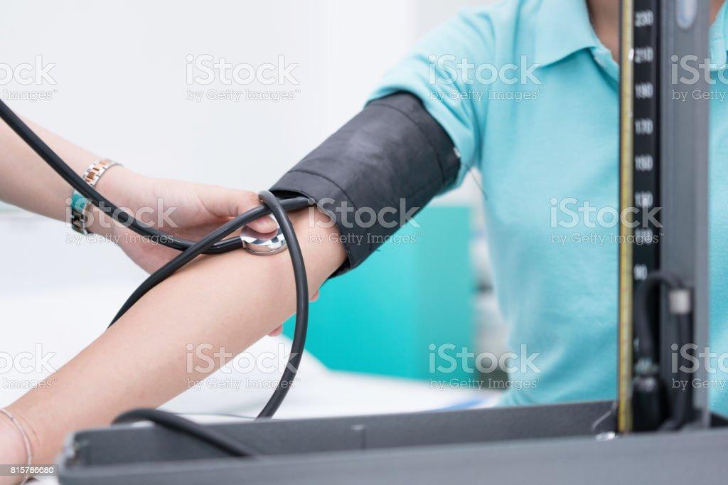 Nursing students are training measurement of blood pressure with sphygmomanometer at nursing school. stock photo