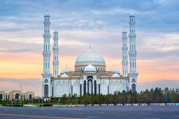 Nur-Sultan, Kasakhstan, beautiful white Hazrat Sultan mosque on sunset Nur-Sultan (Astana), Kasakhstan, beautiful white Hazrat Sultan mosque, the largest mosque in Central Asia, in dramatical sunset light kazakhstan stock pictures, royalty-free photos & images