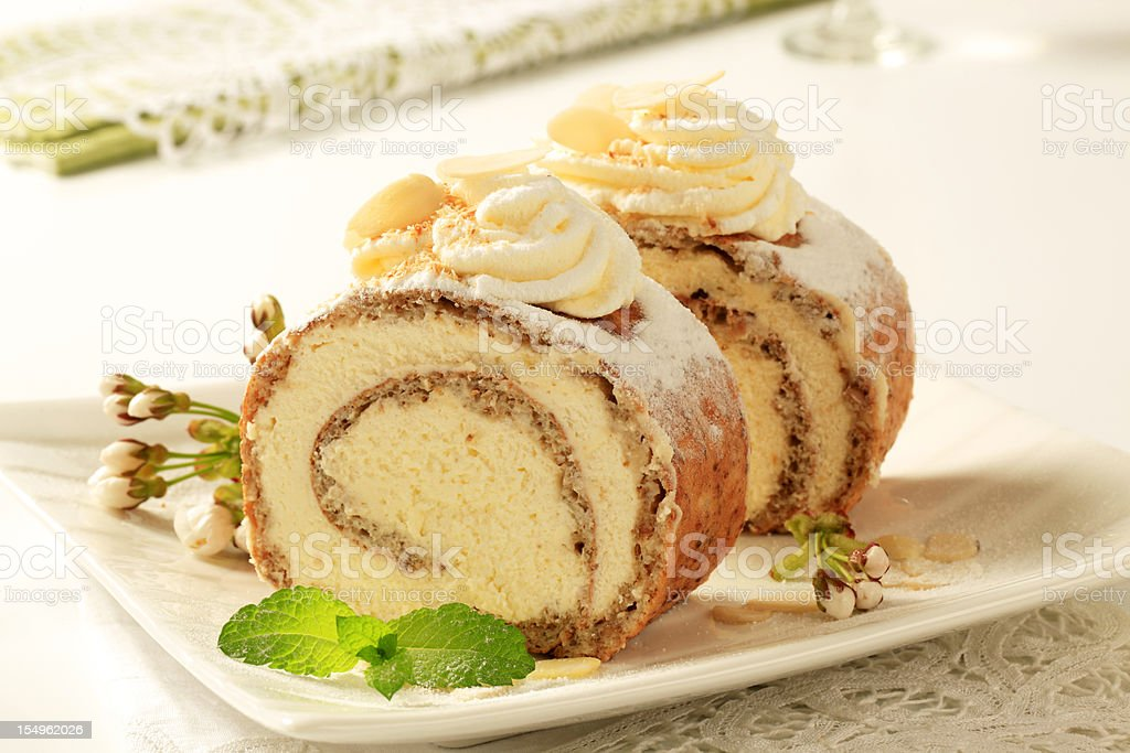 Nut and cream cake roll stock photo