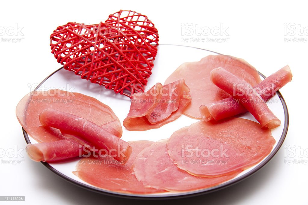 Nut ham with heart on plate stock photo