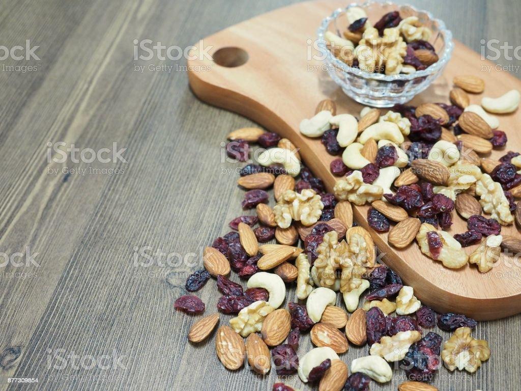 Nut mix, almonds, walnuts, cashew nuts, raspberries, stock photo