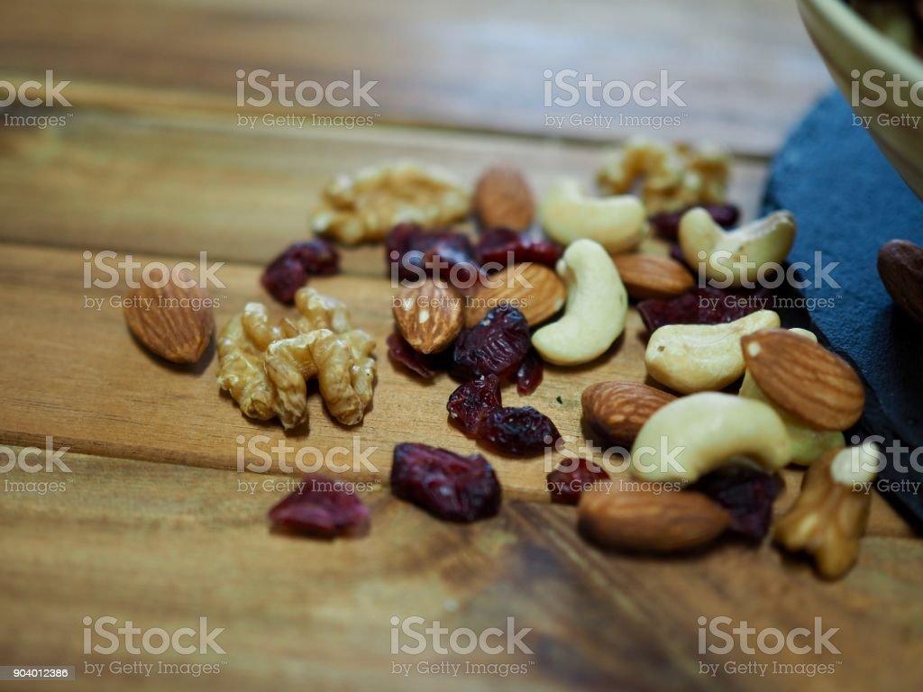 Nut mix, almonds, walnuts, cashew nuts, raspberries stock photo