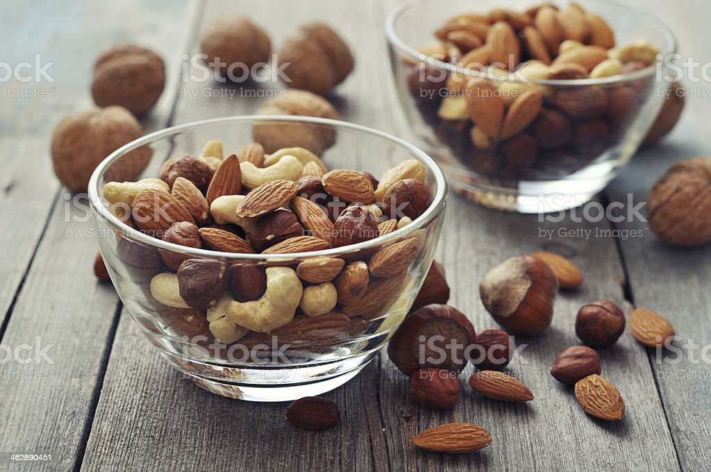 Nut mix in glass bowls stock photo
