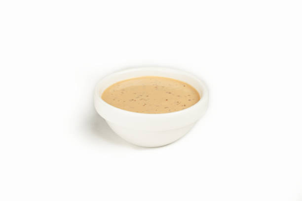 Nut sauce in a bowl on a white background. For the restaurant menu. Traditional Japanese sushi seasoning. Healthy eating. stock photo