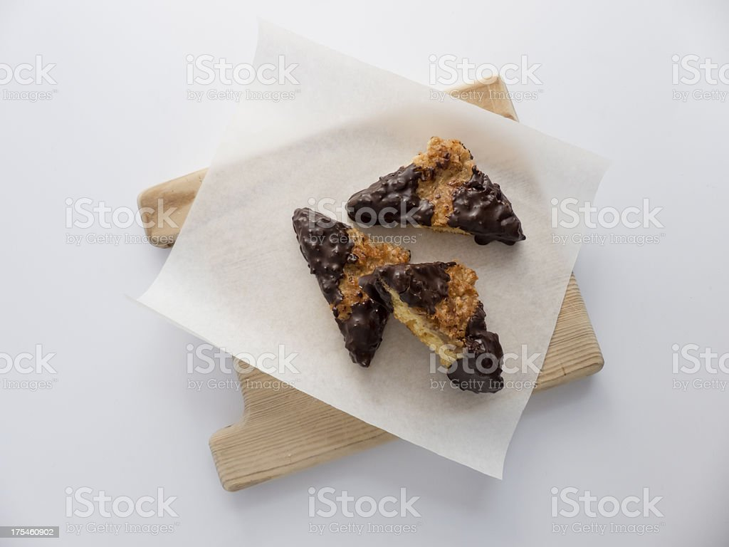 Nut slices on wooden board stock photo