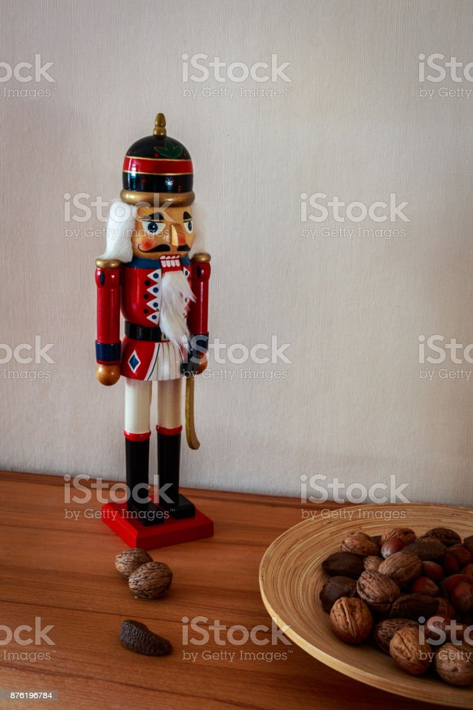 Figur of a nutcracker with nuts as decoration for Advent and Christmas