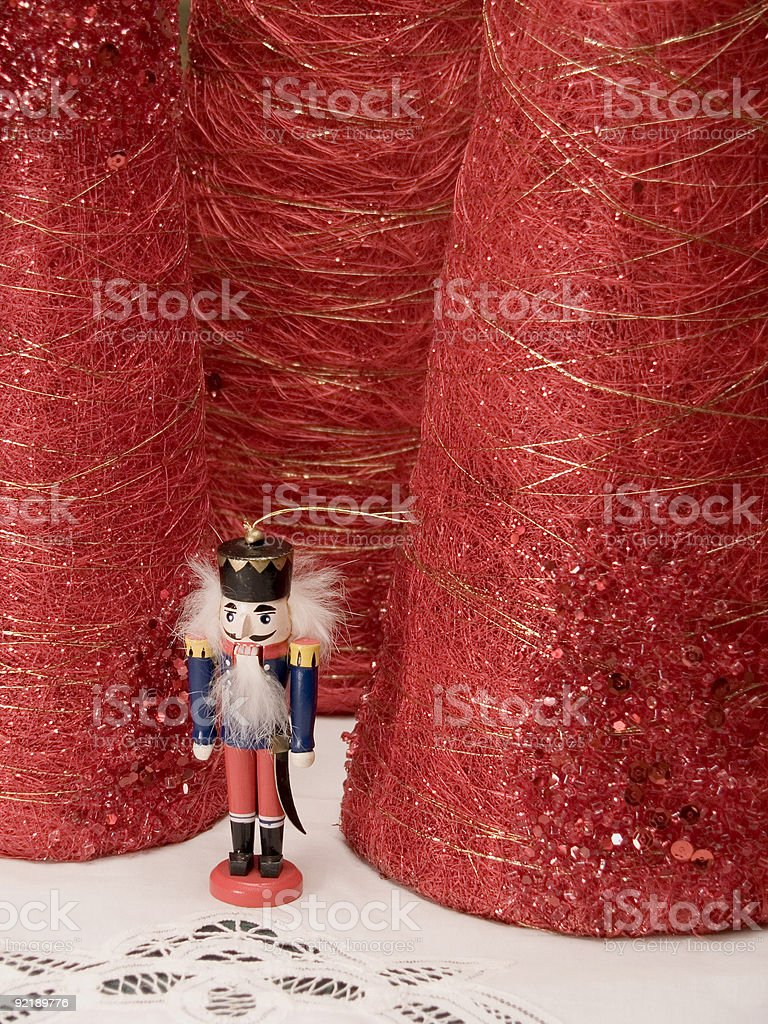 Nutcracker ornament with table decorations. royalty-free stock photo