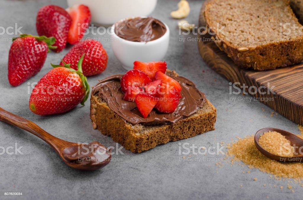 Nutella spread with wholegrain bread stock photo