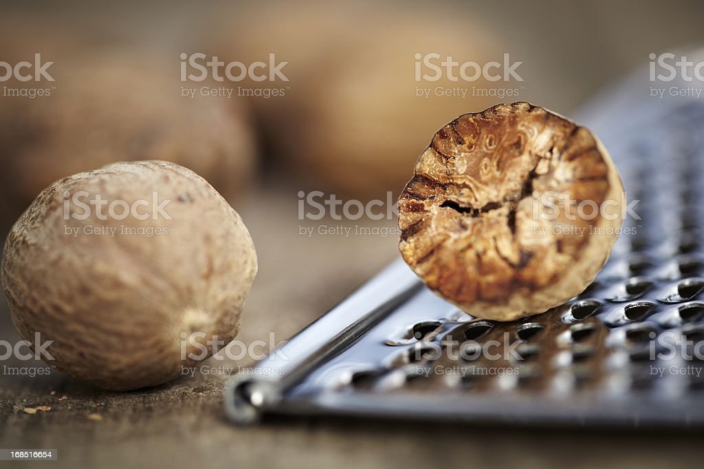 Nutmeg and grater stock photo