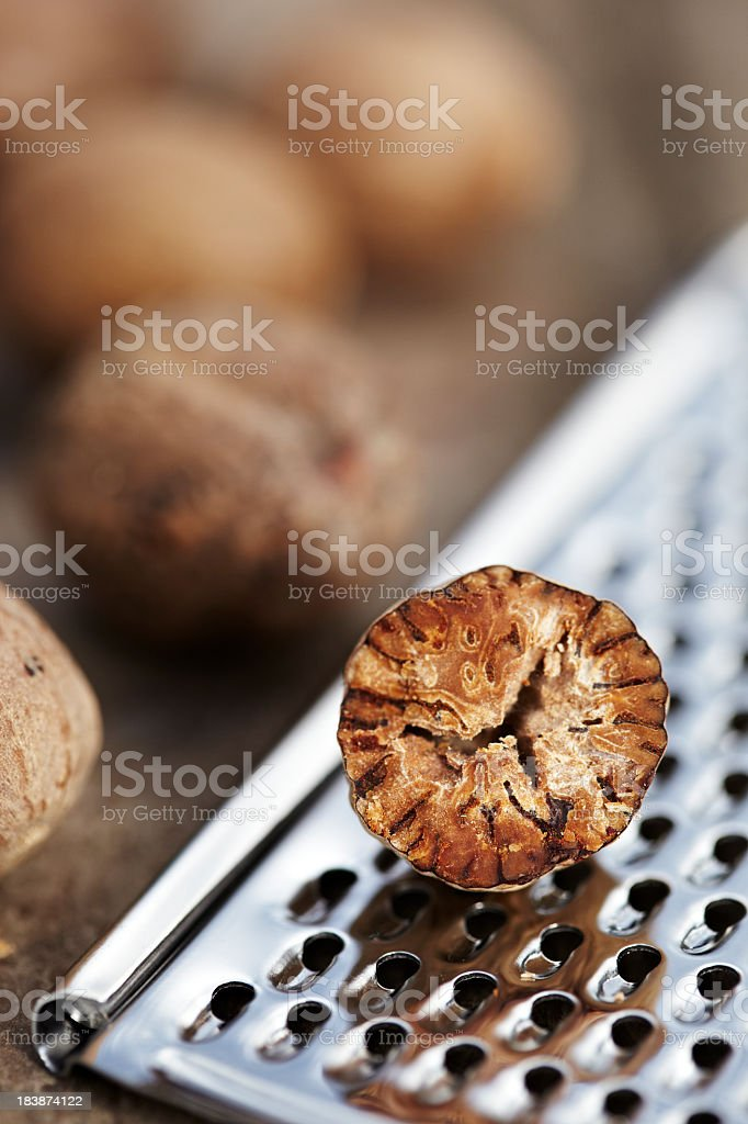 Nutmeg and grater royalty-free stock photo