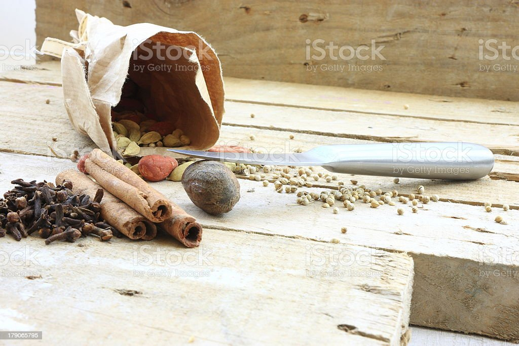 Nutmeg and knife royalty-free stock photo