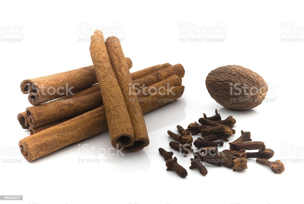 nutmeg, cinnamon and cloves stock photo