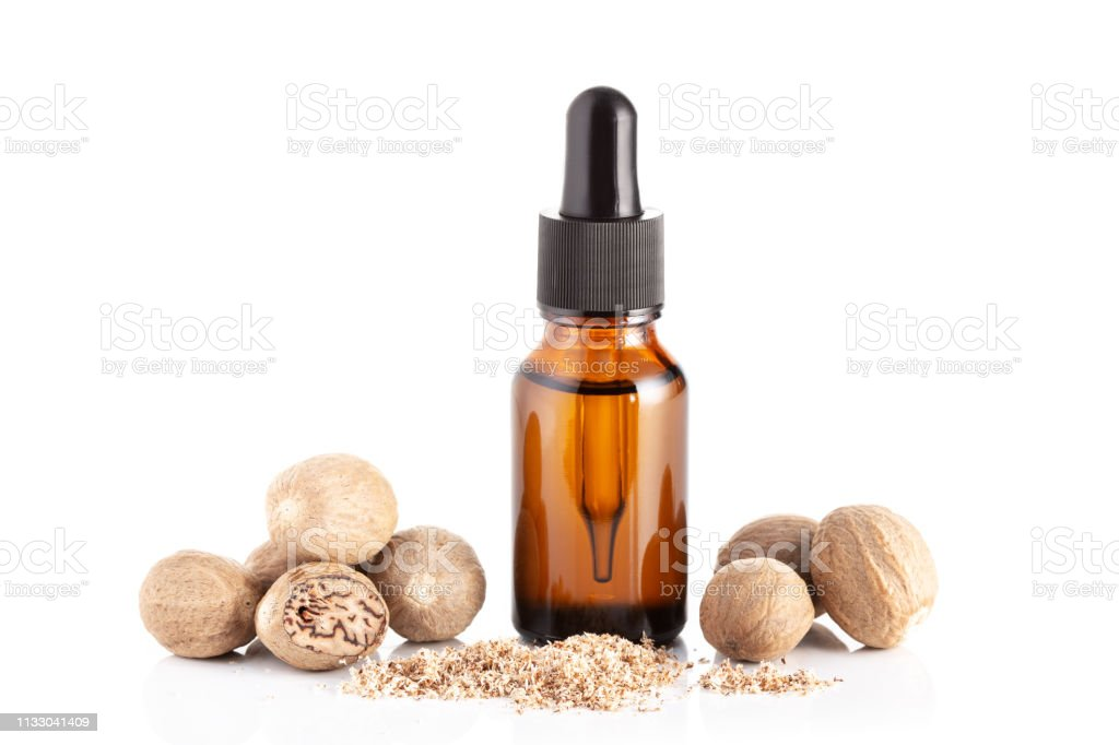 Nutmeg essential oil isolated on white background stock photo