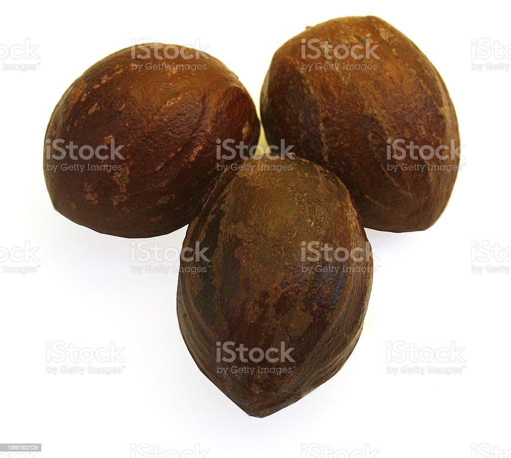 nutmeg in white background. royalty-free stock photo