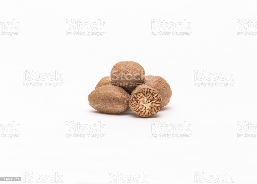 Nutmeg on a white background close-up stock photo