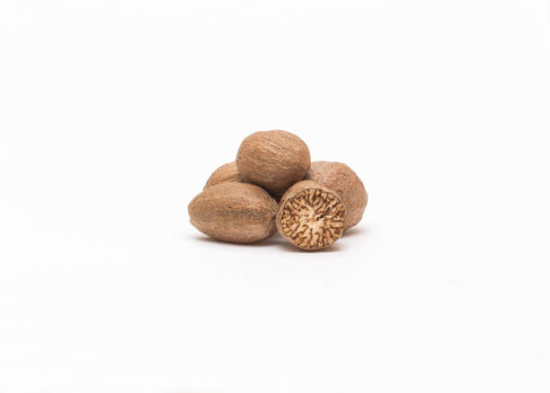 Nutmeg on a white background close-up nutmeg isolated on white background with shadow nutmeg stock pictures, royalty-free photos & images
