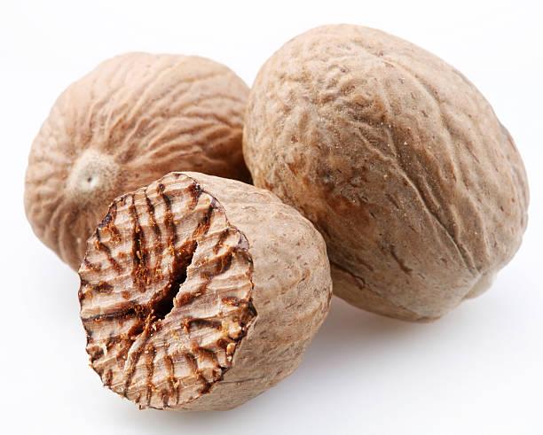 Nutmeg on a white background stock photo