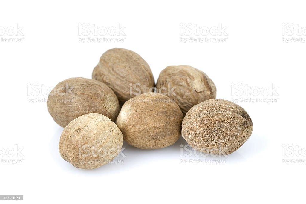 nutmeg on white background royalty-free stock photo