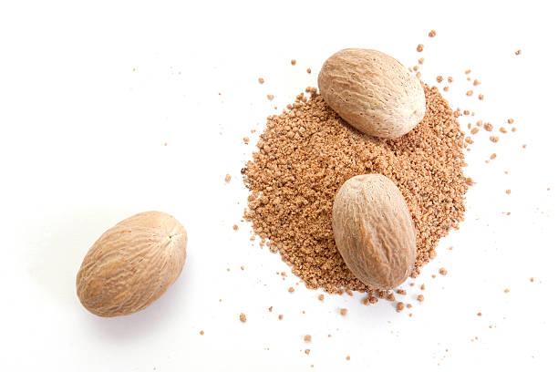 Nutmeg Whole and grated nutmeg isolated on white background nutmeg stock pictures, royalty-free photos & images