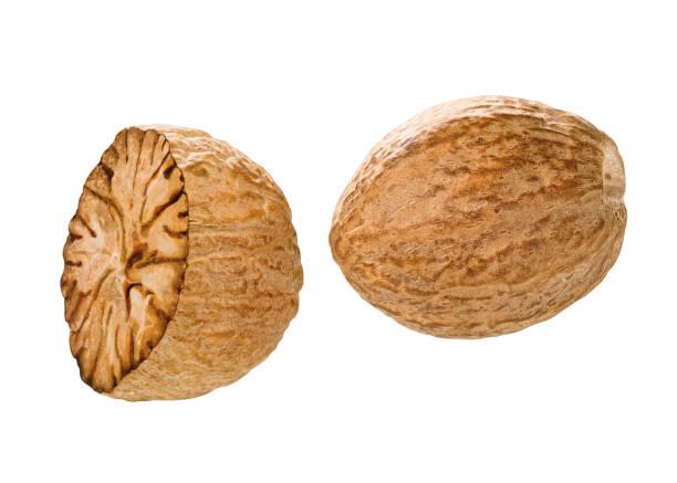 Nutmeg Whole and half nutmeg nuts nutmeg stock pictures, royalty-free photos & images