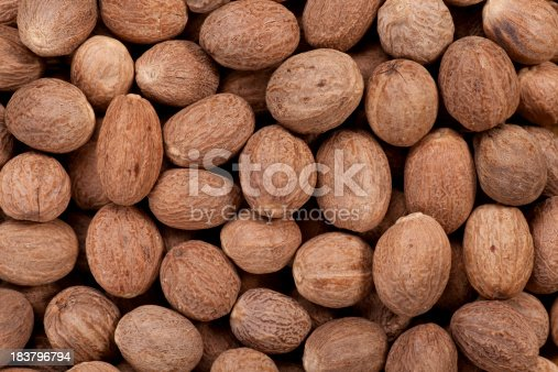 Close up of whole nutmegs as a background.Full Frame.