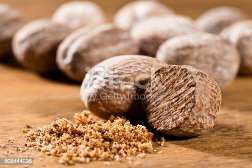 Nutmeg on Wooden Board.