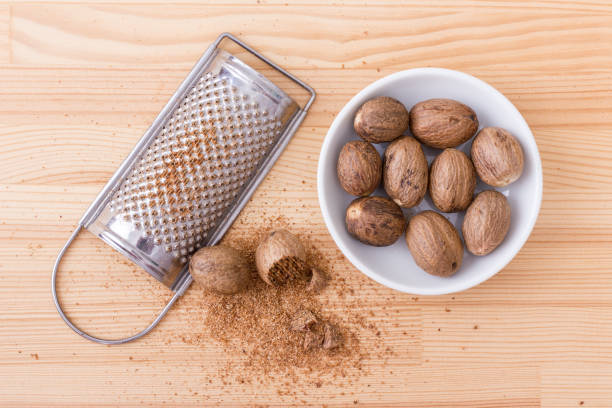 nutmeg Whole and grated muscat nutmeg stock pictures, royalty-free photos & images