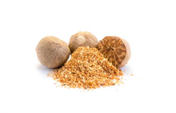 Nutmeg spice powder isolated on white background Nutmeg spice powder isolated on white background nutmeg stock pictures, royalty-free photos & images