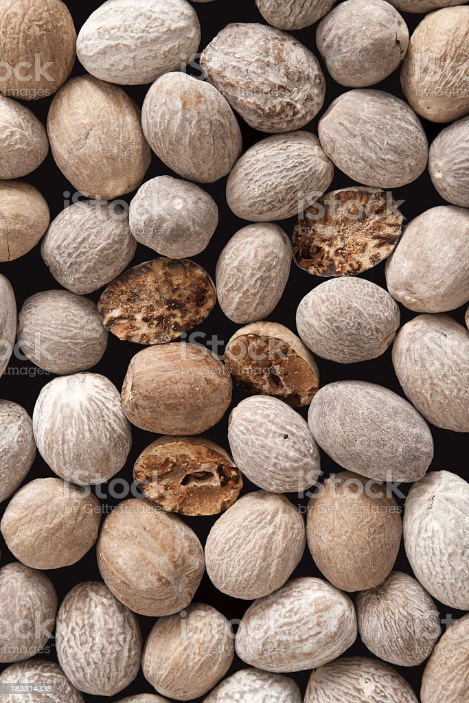 Nutmegs background royalty-free stock photo