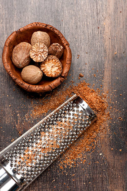 Nutmegs grated Nutmegs grated nutmeg stock pictures, royalty-free photos & images