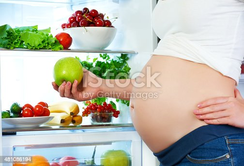 istock nutrition and diet during pregnancy. Pregnant woman with fruits 481086194