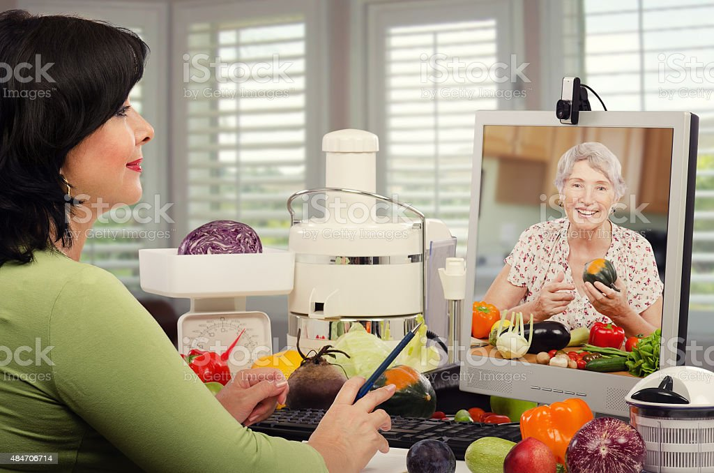 Nutrition consultant giving advice senior woman stock photo