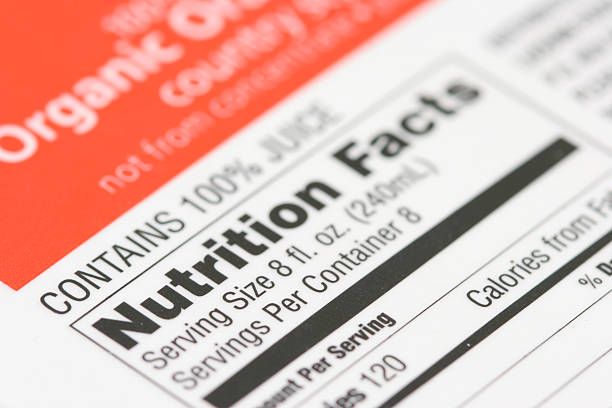 nutrition facts from a box of orange juice - nutrition label stock photos and pictures