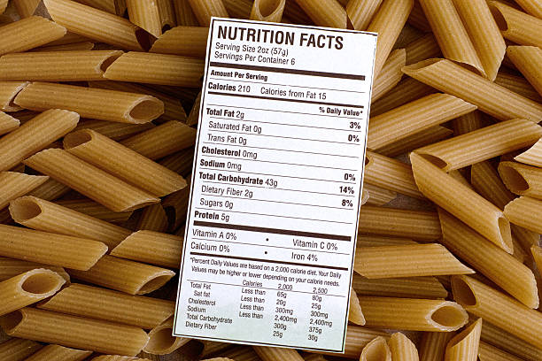 nutrition facts of brown rice pasta - nutrition label stock photos and pictures