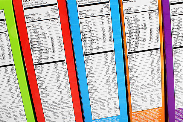 Nutrition information labels on colorful packaging stock photo