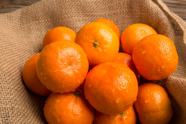 Nutrition Weight loss concept, Top View Bright Healthy organic orange fruit for weight loss and fiber. Boost immune system stock photo