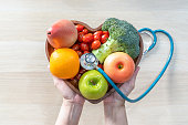 istock Nutritional food for heart health wellness by cholesterol diet and healthy nutrition eating with clean fruits and vegetables in heart dish by nutritionist and doctor recommended for patient well-being 1296507353